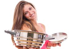 beautiful young woman housewife with a kitchen saucepan pot - stock photo