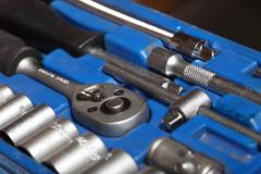 Closeup toolkit set tools in blue box Stock Photos