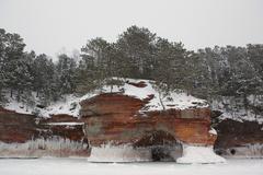Apostle Islands Sea Caves - Frozen Lake Superior Winter - stock photo
