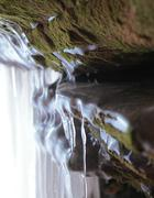 Apostle Islands Sea Caves - moss on icy cave wall - stock photo