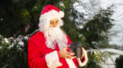 Santa looks gift gifts Stock Footage
