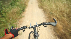 View from handlebars of man on bike on dirt track pov Stock Footage