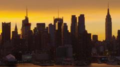 Midtown Manhattan Against a Golden Sky - stock footage