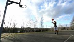Wide angle shot of a basketball player taking a free throw Stock Footage