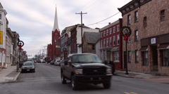 Cars travel though a small town villiage during Christmas - stock footage