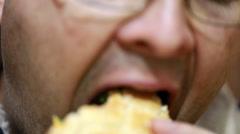 man eating his hamburger - stock footage
