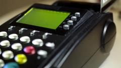Credit card swipe through PIN terminal - stock footage