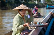 Stock Photo of floating vendors on long wooden boat