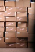 Shipping boxes in warehouse Stock Photos