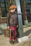 Kid with vintage suitcases waiting on his train to arrive Stock Photos