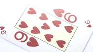 Stock Video Footage of Nine of Hearts playing card rotates on white background