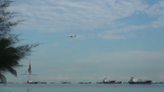 Plane landing at the beach front airport in Singapore Stock Footage