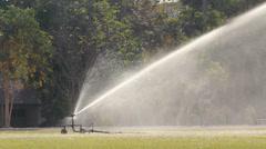Sprinkler head watering the grass Stock Footage