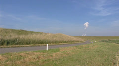 Pan sea dike + polder landscape of Zeeuws Vlaanderen in The Netherlands Stock Footage