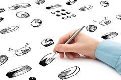Liikemies piirustus ympyräkaaviot ja muut infographics vuonna muistilehtiö Kuvituskuvat