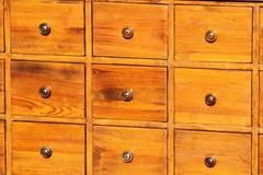 antique chest of drawers in solid wood with brass knobs on sale - stock photo