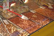 Stock Photo of almonds and almond and sugary sweets for sale in candy store