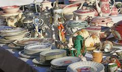furnishings and ceramic plates for sale vintage shop - stock photo