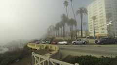 Cars enter/exit fog Stock Footage