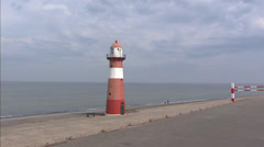 ZEELAND, THE NETHERLANDS: Westkapelle lighthouse + pan sea dike Stock Footage