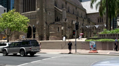 Tilt from traffic to the Cathedral of St Stephen downtown Brisbane Stock Footage
