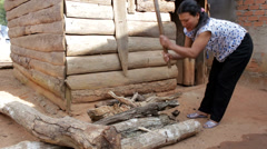 Woman Chops Firewood in Vietnam Stock Footage