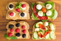 Four healthy open sandwiches for a picnic lunch Stock Photos