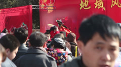 Visitors watch Chinese play  during Chinese Spring Festival in Beijing Stock Footage