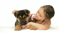 Little cute girl stroking puppy Shepherd Stock Footage