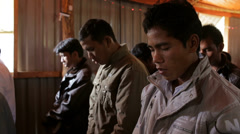 Vietnamese Christian Men Pray in Church Stock Footage