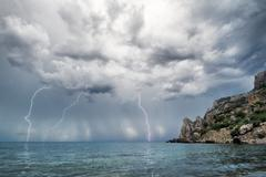 lightning and thunderstorm above sea - stock photo