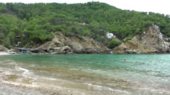 Europe Spain Balearic Ibiza coves and landscapes 014 waves in bay cala benirras Stock Footage