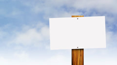 Blank vintage sign against sky time lapse Stock Footage