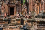 Stock Photo of monkey statues banteay srei hindu pink temple cambodia