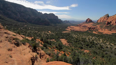 Wide angle, slow pan of scenic overlook in Sedona's desert mountains Stock Footage