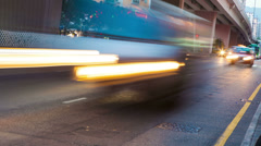 Time lapse car head lights in city traffic Stock Footage