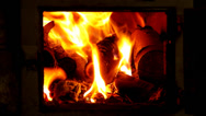 Stock Video Footage of Tiled stove with fire