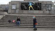 Stock Video Footage of Teenagers playing skaters in front of a monument painted in colors of Ukraine