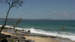 Man walking on the beach close to the coastal walk in Noosa National Park Stock Footage