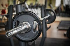 Barbell ready to workout, indooors, shallow dof Stock Photos