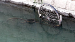 The Old bike in the river water Stock Footage