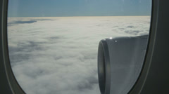 View through window of aeroplane as it flies through clouds Stock Footage