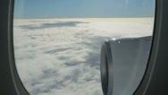 Stock Video Footage of view through window of aeroplane as it flies through clouds