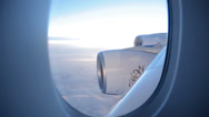 Stock Video Footage of view through window of emirates a380 airplane as it flies through clouds
