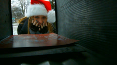 Young Woman looking in Mailbox excitedly for Christmas Cards - stock footage