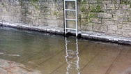 Stock Video Footage of Metal ladder on stone wall at  river