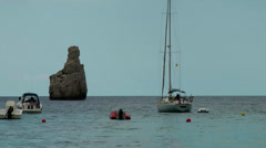 Europe Spain Balearic Ibiza coves and landscapes 017 cliff with sailing boat Stock Footage