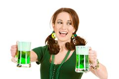 Stock Photo of green: woman laughing to side with green beer
