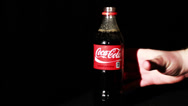 Stock Video Footage of Coca-Cola Bottle Being Picked Up
