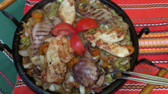 Steamy Balkans dish, meal, pan with chicken breast and vegetables Stock Footage